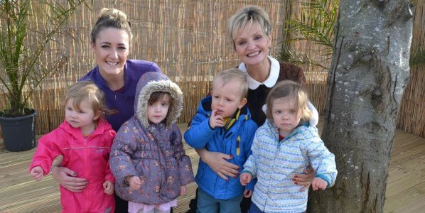 Staff members, Charlotte Lewis (Senior Practitioner) and Jane Smalley (Principal and Managing Director) pictured with Florence, Olivia, Oscar and Beatrice