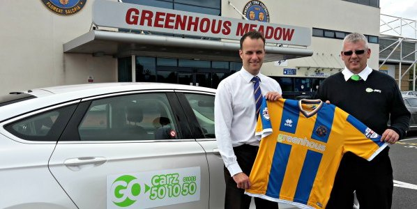 Shrewsbury Town's Richard Hill with Steve Hughes, of Go Carz, at the Greenhous Meadow.