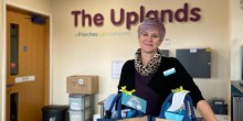 Fee Glover at The Uplands receiving their self-care hampers