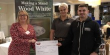 Julie Williams, Butterfly Conservation CEO, receiving a cheque from Toby and Terri Siveter from Wood's