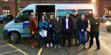 Maths teacher Kate Curzon and Col Martin Clewlow with students leaving Ellesmere College for Manchester.