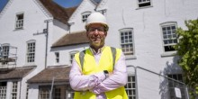 Riverside Inn manager, Chris Kendall, stands outside the pub during the refurbishment.