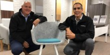 Chrisbeon's Craig and Richard Hughes with a chair made of recycled bottles.