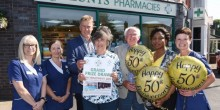 Ken, Joan and Martin Lunt with staff outside their pharmacy in Roushill as they celebrate a golden year