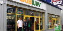 Ryan Talbot, from Rent a Space, Rebecca Welch of Halls Commercial and Harry Singh of Subway are delighted with the move