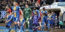 Shrewsbury Town players and mascots walking out on to the pitch