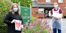 Morris Care Centre Home Manager, Claire Smith (L), thanking Care Practitioner, Vicki Fletcher (R) at Ercall Court, Part of Care Centre
