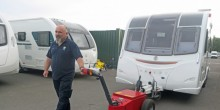 Salop Leisure's touring aftersales engineer Ian Hart using the Multi-Mover XL50 to move a touring caravan.