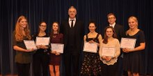 Award winning students at Thomas Adams School are congratulated by comedian Greg Davies