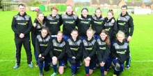 Saha Sabres girls football team with their coaches, sponsored by Greenfield IT Recruitment