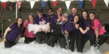 Shropshire Festivals team holding Beth Heath in foam party