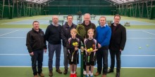 Representatives from Tennis Scotland and Ellesmere Tennis Academy with year 5 pupils Adam and Thomas Jacques at the award winning Tennis Centre at Ellesmere College