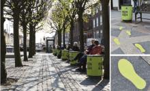 Green footprints on the street in Copenhagen
