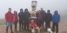pensionlite staff and volunteers on top of the wrekin with their giant duck